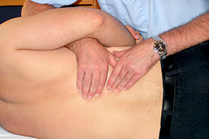 Physio providing treatment for back pain